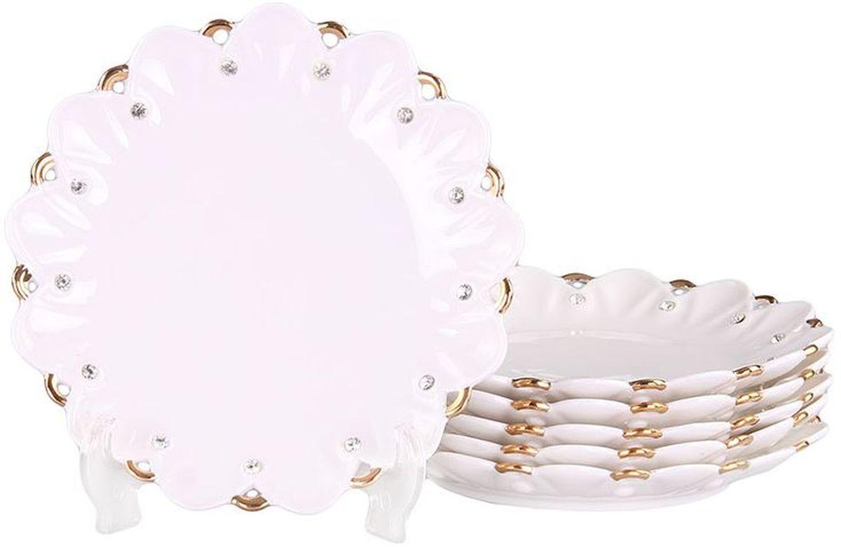 Набор десертных тарелок 6 шт 19 см PATRICIAIM520190Тарелки изготовлены из фарфора безупречной белизны, помогут вам сервировать стол с особым шармом. Изделия украшены позолотой и стразами. Набор имеет подарочную упаковку с шелковый лентой.