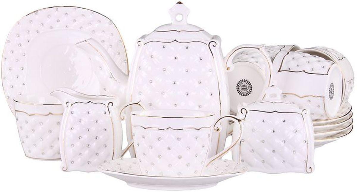 Набор чайный 15 пр. 220 мл PATRICIAIM553016Чайный набор включает в себя 15 предметов: 6 чашек (220мл.), 6 блюдец, заварочный чайник (500мл.), молочник и сахарницу. Изделия выполнены из фарфора безупречной белизны. Все элементы набора украшены стразами и золотым декором. Набор имеет подарочную упаковку с шелковой лентой. Внимание! Изделия нельзя использовать в посудомоечной машине.