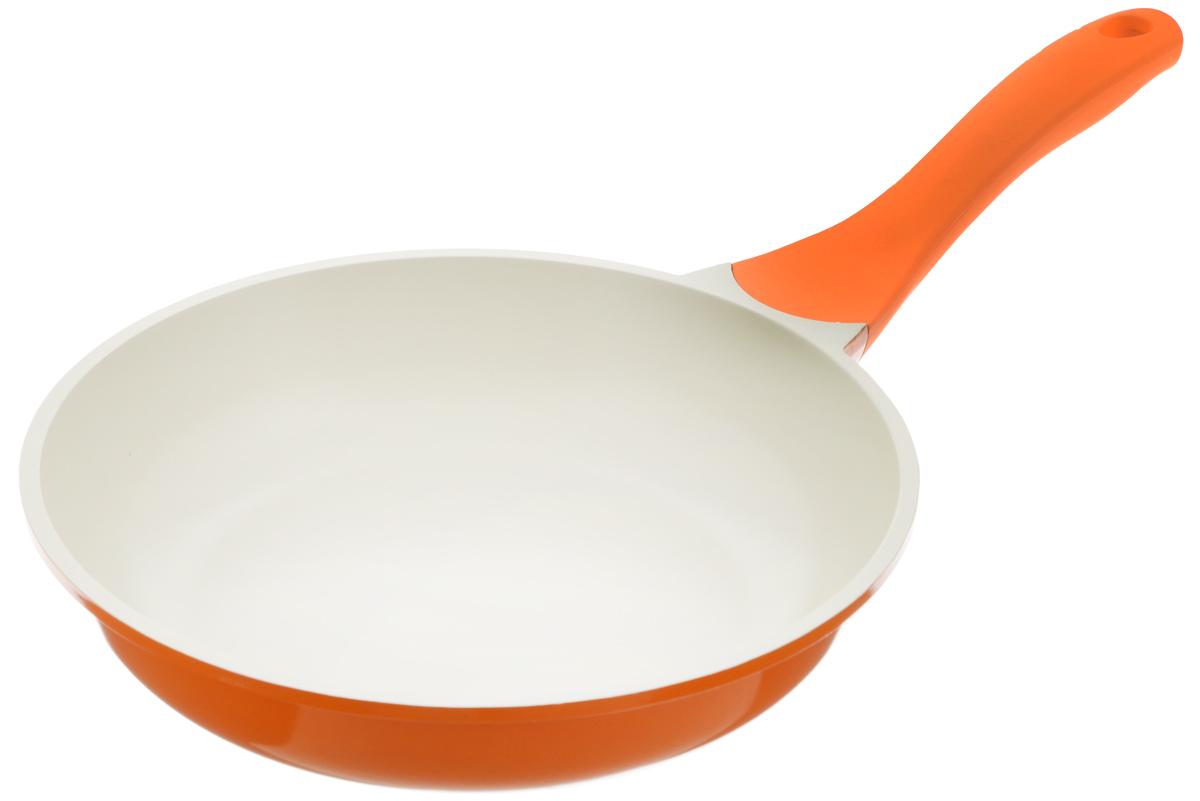 Сковорода Biostal, с керамическим покрытием, цвет: оранжевый, бежевый. Диаметр 24 см. FP-24Bio-FP-24 оранж/бежСковорода Biostal выполнена из литого алюминия с многослойным керамическим покрытием Ceralon на основе натуральных компонентов швейцарского производства Ilag. Утолщенное дно изделия обеспечивает равномерное распределение тепла по всей рабочей поверхности. Ненагревающаяся эргономичная ручка из бакелита с покрытием soft-touch обеспечит удобный захват, превращая процесс приготовления пищи в удовольствие. Можно готовить с минимальным количеством масла. Подходит для использования на газовых, электрических и стеклокерамических плитах, кроме индукционных. Можно мыть в посудомоечной машине. Диаметр сковороды: 24 см. Высота стенки: 6 см. Длина ручки: 20 см.