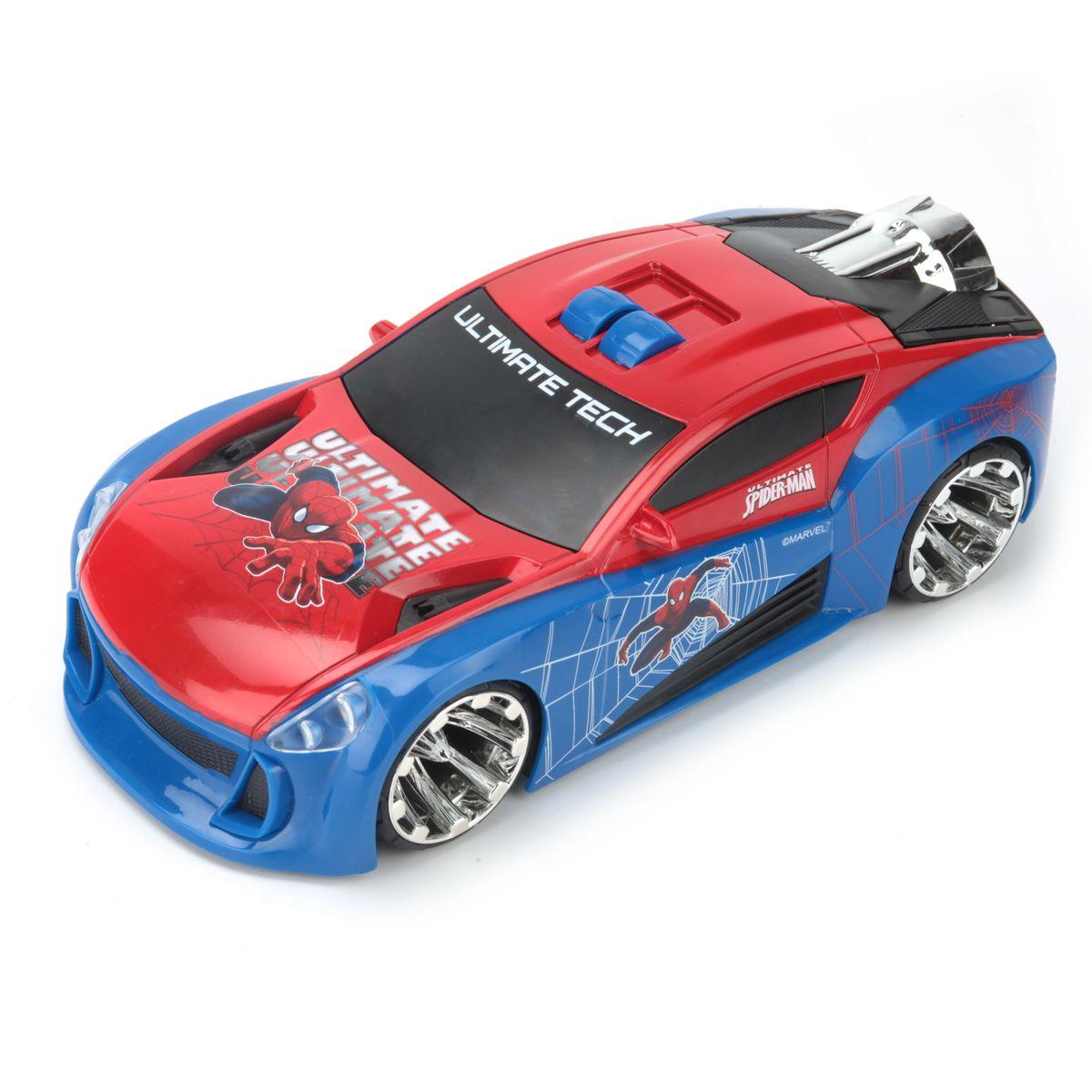 Toystate Машина Человек-паук цвет красный синий33345SPЯркая машинка Человек-паук со звуковыми и световыми эффектами, несомненно, понравится вашему ребенку и не позволит ему скучать. Игрушка выполнена в виде большой яркой гоночной машины. На крыше машины расположены 2 кнопки, при нажатии на кнопку 1 под музыкальное сопровождение загораются фары и турбина. При нажатии на кнопку 2 машина встает на дыбы и выдвигается турбина. Ваш ребенок часами будет играть с машинкой, придумывая различные истории и устраивая соревнования. Порадуйте его таким замечательным подарком! Рекомендуется докупить 3 батарейки AА (товар комплектуется демонстрационными).