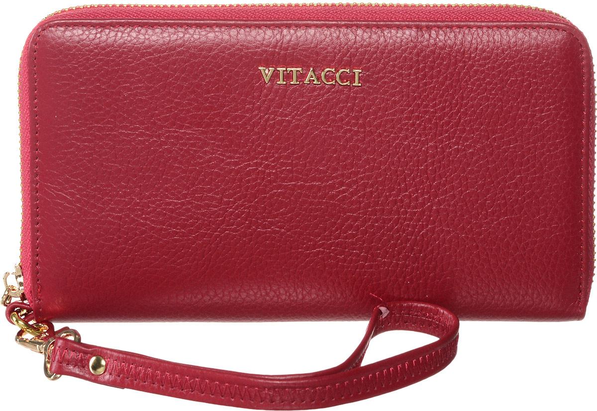Кошелек женский Vitacci, цвет: красный. HS021HS021Кошелек Vitacci выполнен из высококачественной натуральной кожи. Кошелек закрывается на застежку-молнию. Внутри кошелька имеется отделение для мелочи на молнии, два открытых кармана для бумаг или купюр, двенадцать отделений под визитки или карточки. В комплекте идет съемный ремешок, который позволяет носить кошелек на руке. Классический дизайн и стильный декор в сочетании с удобством и вместительностью делают этот аксессуар незаменимым.