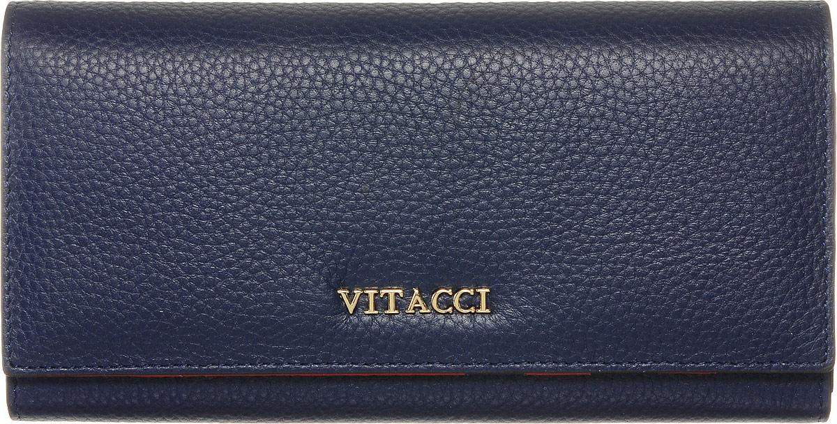 Кошелек женский Vitacci, цвет: темно-синий. HS010HS010Кошелек Vitacci выполнен из высококачественной натуральной кожи. Кошелек закрывается на большой клапан с кнопкой. Внутри кошелька имеется отделение для мелочи на молнии, три отделения для купюр, один открытый карман, девять отделений под визитки или карточки. Спереди имеется карман для мелочи или купюр, который закрывается на замок-фермуар. Классический дизайн и стильный декор в сочетании с удобством и вместительностью делают этот аксессуар незаменимым.