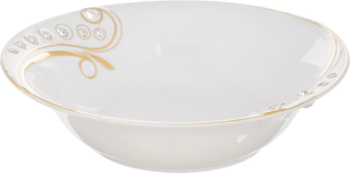 Салатник Elan Gallery Хрустальная ветка, 1 л580143Великолепный круглый салатник Elan Gallery Хрустальная ветка, изготовленный из высококачественного фарфора, прекрасно подойдет для подачи различных блюд: закусок, салатов или фруктов. Такой салатник украсит ваш праздничный или обеденный стол, а оригинальное исполнение понравится любой хозяйке. Не рекомендуется применять абразивные моющие средства. Не использовать в микроволновой печи и не мыть в посудомоечной машине. Диаметр салатника (по верхнему краю): 22,5 см.