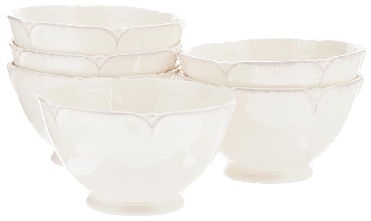 Набор салатников Lillo Ideal, диаметр 14 см, 6 шт214202Набор Lillo Ideal состоит из 6 салатников одинакового размера Изделия, изготовленные из высококачественной керамики, сочетают в себе изысканный дизайн с максимальной функциональностью. Они идеально подходят для сервировки стола и подачи закусок, солений и других блюд. Такие салатники прекрасно впишутся в интерьер вашей кухни и станут достойным дополнением к кухонному инвентарю. Диаметр салатника: 14 см. Высота салатника: 8 см.