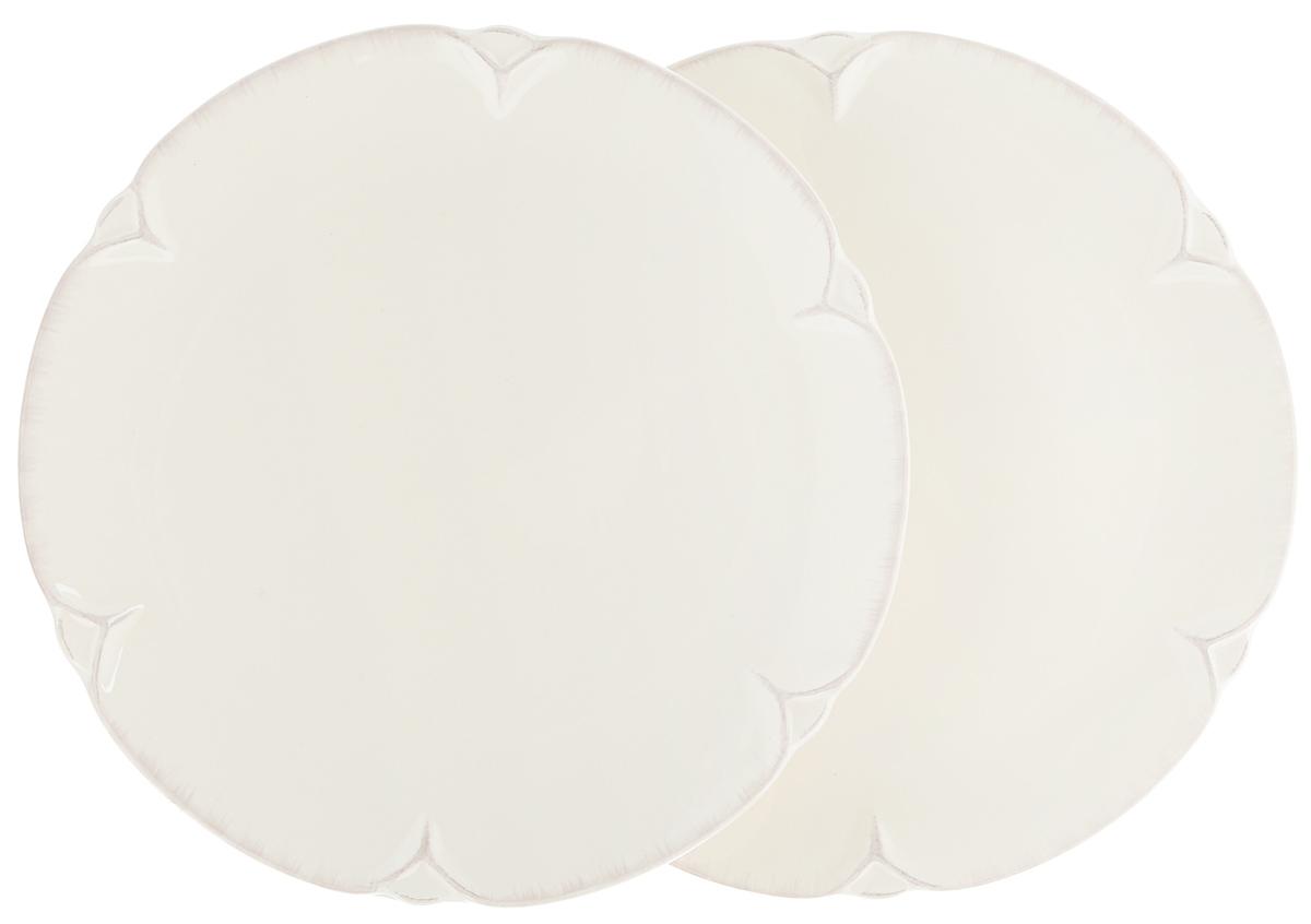 Набор тарелок Lillo Ideal, диаметр 22,5 см, 2 шт214205Набор Lillo Ideal состоит из 2 круглых тарелок, выполненных из керамики. Изделия предназначены для красивой сервировки различных блюд. Набор сочетает в себе стильный дизайн с максимальной функциональностью. А оригинальность оформления придется по вкусу и ценителям классики, и тем, кто предпочитает утонченность и изящность. Диаметр тарелки: 22,5 см. Высота тарелки: 2 см.