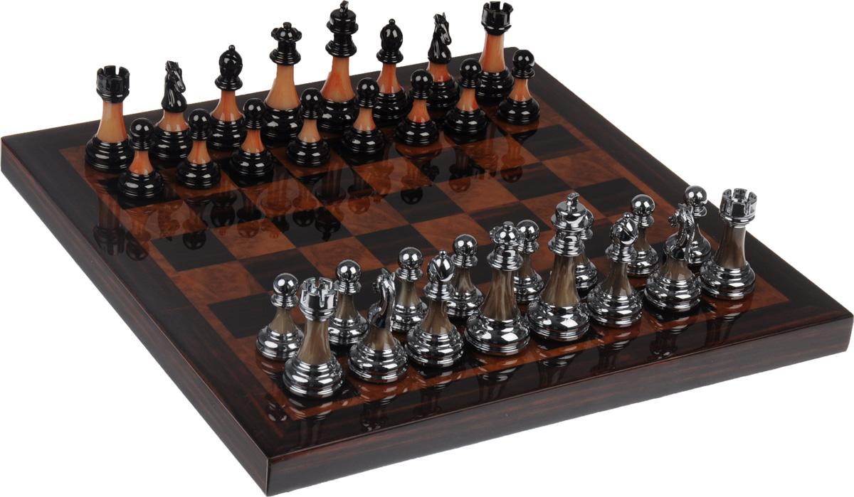 Шахматы Русские Подарки44536Шахматы Русские Подарки - коллекционная настольная игра, которая станет достойным подарком для начальника, партнера или друга. Изделие представляет собой шахматные фигуры и деревянную доску с игровым полем. Внешняя поверхность - игровое поле. Нижняя поверхность оформлена бархатистым текстилем. Размер игрового поля: 38,5 х 38,5 см. Средняя высота шахматных фигур: 6,5 см.