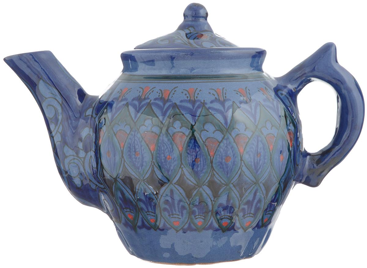 Чайник заварочный Sima-land Риштан, цвет: синий, красный, 600 мл. 12334121233412Заварочный чайник Sima-land Риштан изготовлен из высококачественной керамики. Посуда оформлена ярким узором. Такой чайник идеально подойдет для заваривания чая. Он хорошо держит температуру, что способствует более полному раскрытию цвета, аромата и вкуса чайного букета. Изделие прекрасно дополнит сервировку стола к чаепитию и станет его неизменным атрибутом. Диаметр (по верхнему краю): 8 см. Диаметр основания: 7 см. Высота чайника (без учета крышки): 12 см.