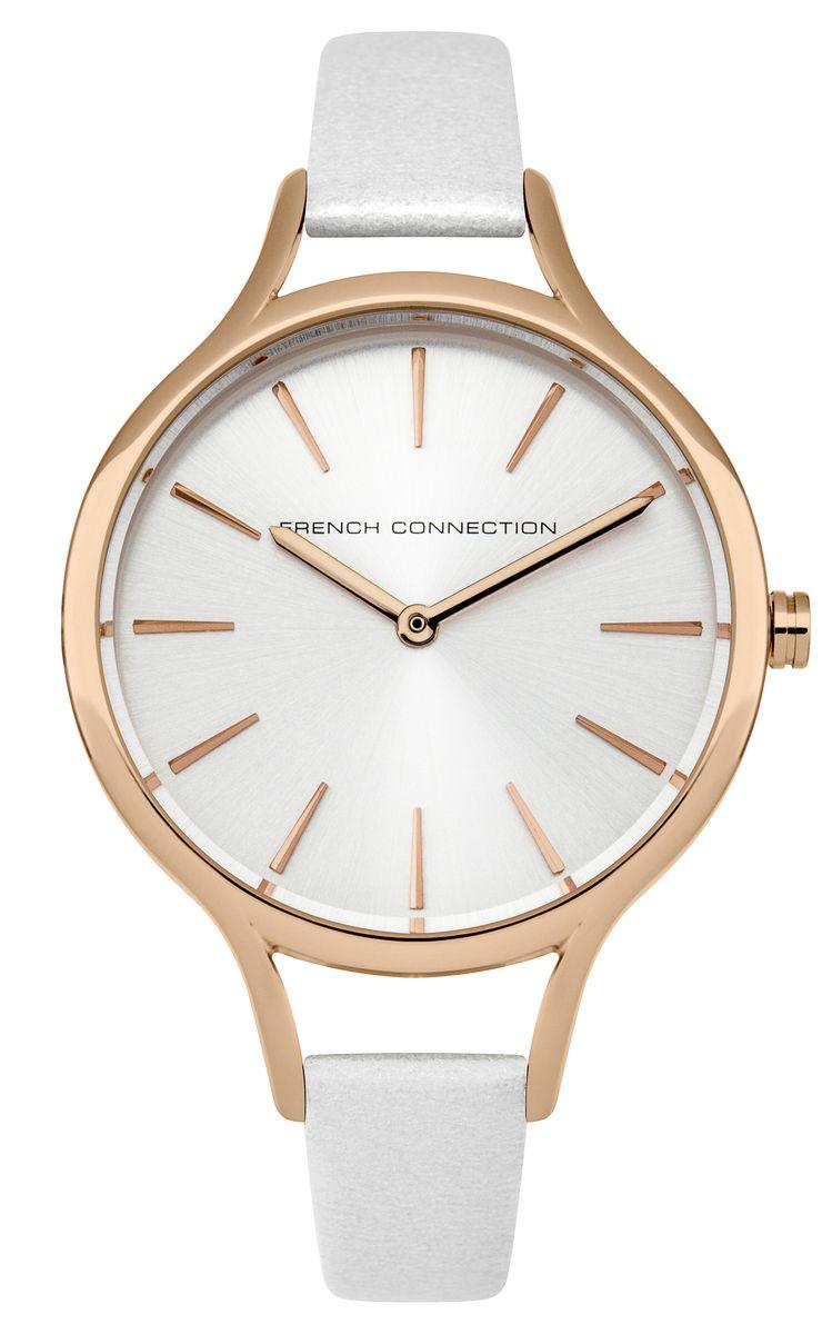Часы наручные женские French Connection Slim Facet, цвет: белый. FC1253WRGFC1253WRGСтильные часы French Connection Slim Facet - это модный и практичный аксессуар, который не только выгодно дополнит ваш наряд, но и будет незаменим для каждой современной девушки, ценящей свое время. Корпус выполнен из нержавеющей стали. Контрастный циферблат оформлен логотипом бренда. Корпус изделия имеет степень влагозащиты 3 Bar, оснащен кварцевым механизмом и дополнен устойчивым к царапинам минеральным стеклом. Изысканный узкий ремешок выполнен из натуральной кожи и дополнен пряжкой, которая позволяет с легкостью снимать и надевать изделие. Часы поставляются в фирменной упаковке. Часы French Connection подчеркнут изящество ваших рук и ваш неповторимый стиль и элегантность.