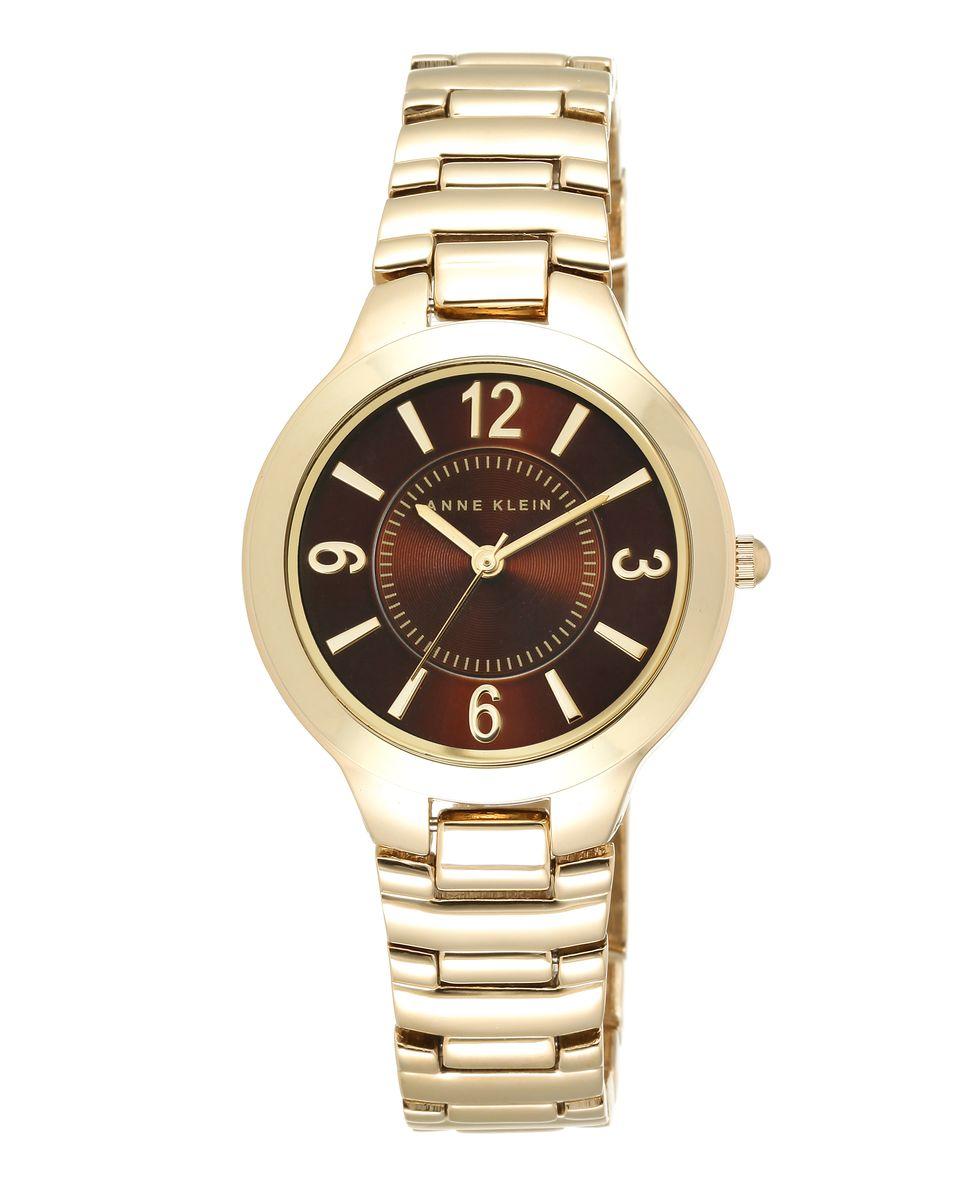 Наручные часы женские Anne Klein Daily, цвет: золотистый. 1450 BNGB1450 BNGBКорпус 32 мм, металлический браслет с покрытием золотого цвета, циферблат коричневого цвета, водозащита 3 АТМ
