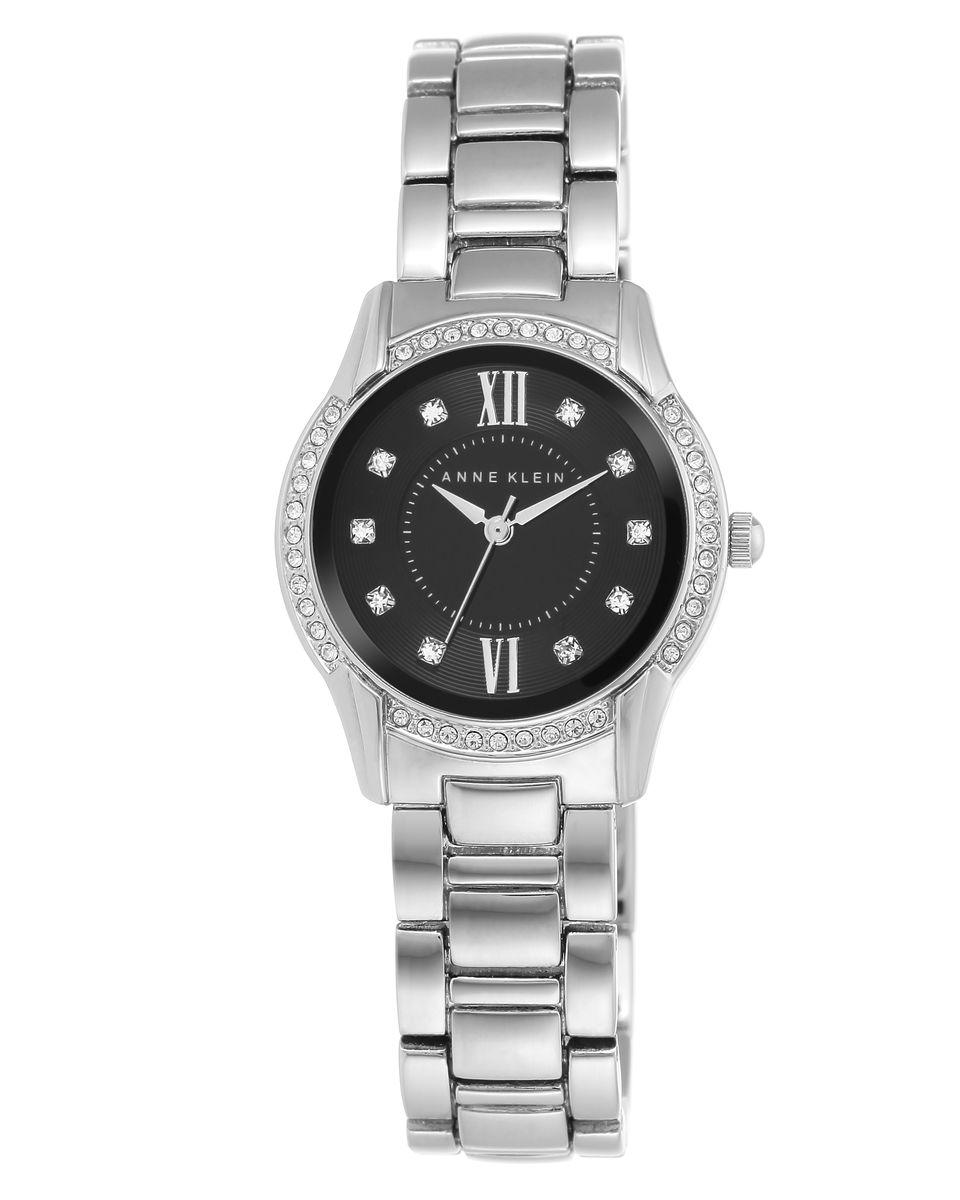 Наручные часы женские Anne Klein Crystal, цвет: серебристый. 2161 BKSV2161 BKSVКорпус 28 мм, циферблат черного цвета, безель украшен кристаллами Swarovski, металлический браслет, водозащита 3 АТМ