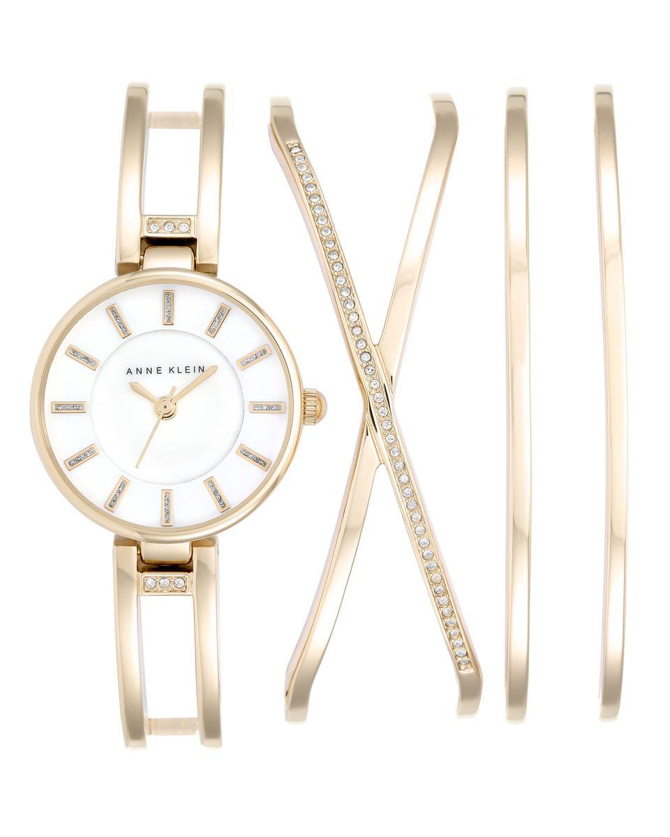 Наручные часы женские Anne Klein Ring, цвет: золотистый. 2236 GBST2236 GBSTКорпус 26 мм, циферблат- натуральный перламутр белого цвета, инкрустация кристаллами Swarovski, 3 дополнительных браслета, золотистое покрытие металла, водозащита 3 АТМ