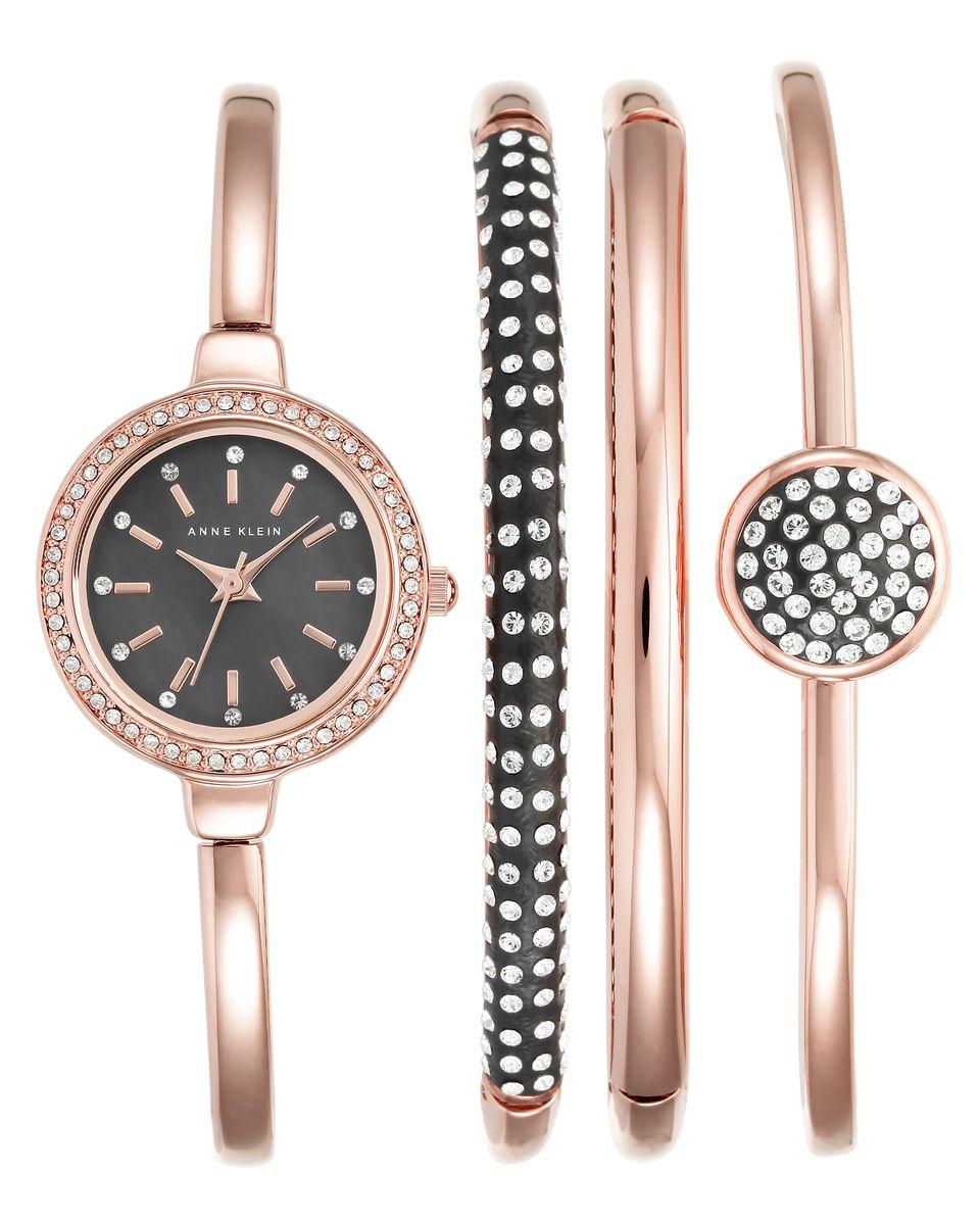 Наручные часы женские Anne Klein Ring, цвет: бледно-розовый. 2240 RGST2240 RGSTКорпус 24 мм, циферблат- натуралный перламутр черного цвета, 3 дополнительных браслета с использованием металла с покрытием розового цвета, безель и браслеты инкрустированы кристаллами Swarovski, водозащита 3 АТМ