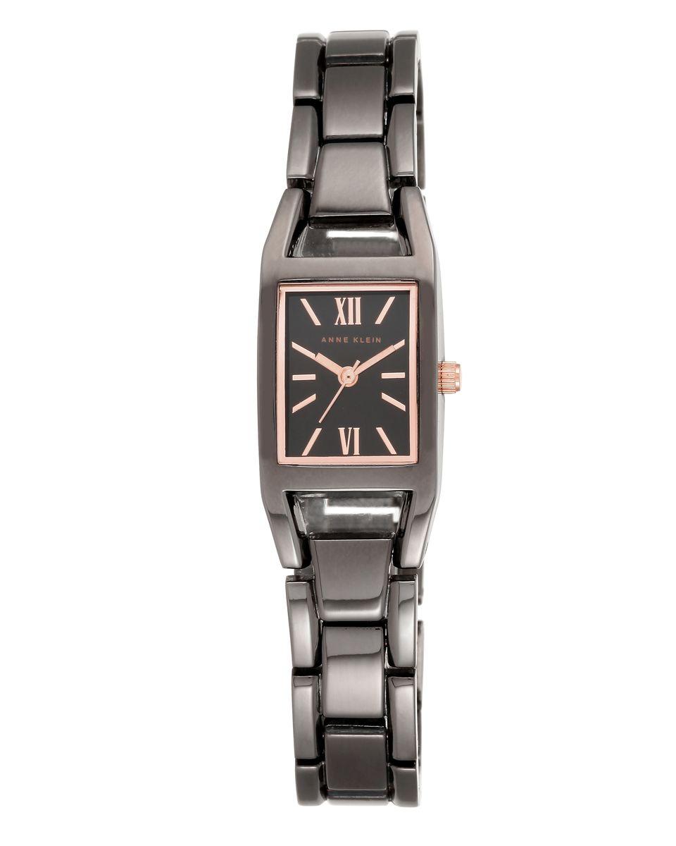 Наручные часы женские Anne Klein Ring, цвет: черный. 6419 GYRT6419 GYRTКорпус 17*36 мм, металлический браслет с покрытием черного цвета, циферблат серого цвета с элеметнами розового цвета, водозащита 3 АТМ