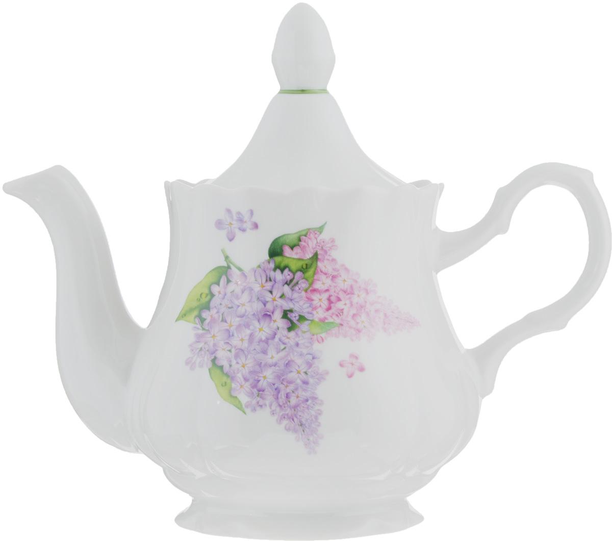 Чайник заварочный Романс. Сирень, 800 мл507772Заварочный чайник Романс. Сирень, выполненный из высококачественного фарфора, покрыт сверкающей глазурью. Изделие оснащено крышкой и украшено цветочным рисунком. Заварочный чайник Романс. Сирень придется по вкусу и ценителям классики, и тем, кто предпочитает утонченность и изысканность. Диаметр (по верхнему краю): 9,5 см. Высота чайника (без учета крышки): 12 см.
