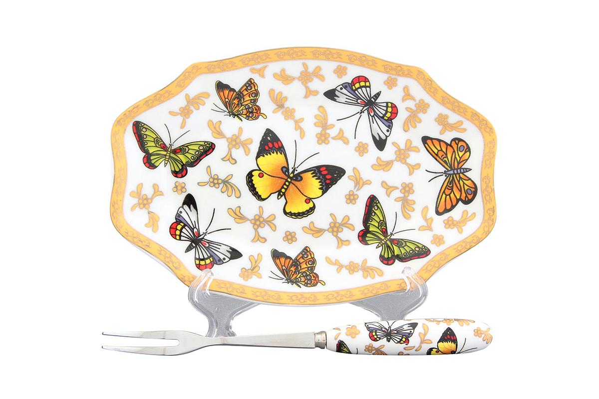 Тарелка под лимон Elan Gallery Бабочки, восьмигранная, с вилкой, 16 х 10,5 х 1,5 см502264Элегантная тарелка под лимон Elan Gallery Бабочки, изготовленная из высококачественной керамики, поможет сервировать нарезанный дольками лимон и другие цитрусовые. Вилка, выполненная из металла, удобна и проста в использовании. Ручка вилки выполнена из фарфора и оформлена изображением бабочек. Не рекомендуется применять абразивные моющие вещества. Не использовать в микроволновой печи. Размер тарелки: 16 х 10,5 х 1,5 см. Длина рабочей поверхности вилки: 3 см. Общая длина вилки: 15,5 см.