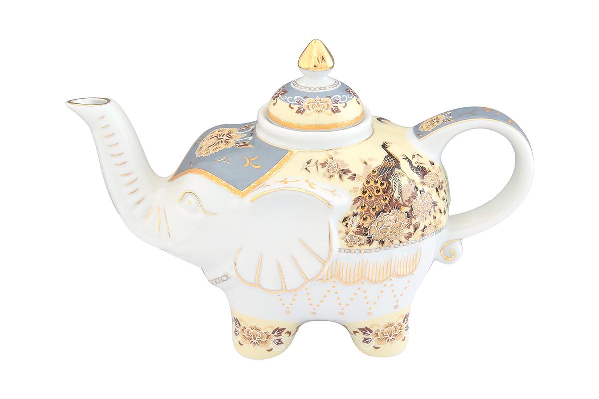 Чайник заварочный Elan Gallery Павлин на бежевом, 750 мл504051Загадочная страна Индия: чай, слоны, солнце, праздник! Чайник, выполненный в форме слона, будет напоминать Вам об Индии и наполнит Ваш дом солнечным настроением. Изделие имеет подарочную упаковку, идеальный подарок для Ваших близких!