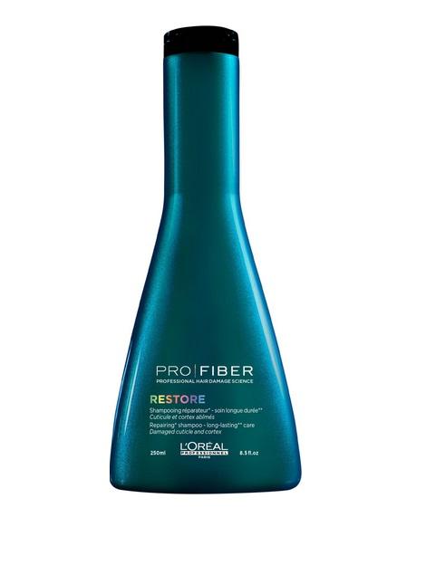 LOreal Professionnel Шампунь для сильно поврежденных волос Pro Fiber Restore Shampoo, 250 млLE1545000LOreal Professionnel Pro Fiber Restore Shampoo - Шампунь для сильно поврежденных волос . Предназначен для ухода за волосами в домашних условиях. С его помощью волосы прекрасно очищаются, они словно оживают от деликатной, мягкой заботы. Активные компоненты: - аминосилан - силиконовое соединение кремния для связывания внутренних слоев волоса в трехмерную сеть - отвечает за укрепление и восстановление структуры. - катионный полимер, покрывающий кутикулу волоса защитной пленкой и «герметизирующий» комплекс Aptyl 100 внутри волоса. Ваши волосы вновь станут сильными, здоровыми, мягкими и шелковистыми.