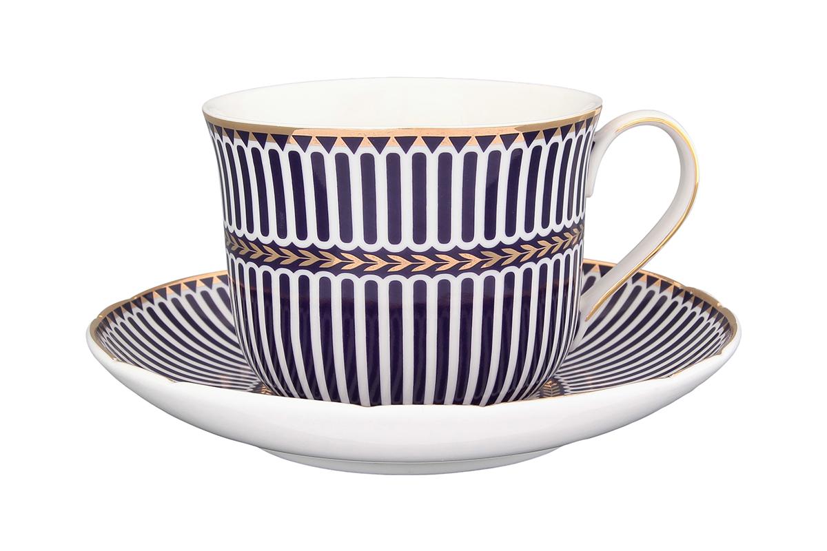 Чайная пара Elan Gallery Синие полоски, 2 предмета730536Чайная пара Elan Gallery Синие полоски состоит из чашки и блюдца, изготовленных из керамики высшего качества. Яркий дизайн, несомненно, придется вам по вкусу. Чайная пара Elan Gallery Синие полоски украсит ваш кухонный стол, а также станет замечательным подарком к любому празднику. Не рекомендуется применять абразивные моющие средства. Не использовать в микроволновой печи. Объем чашки: 400 мл.
