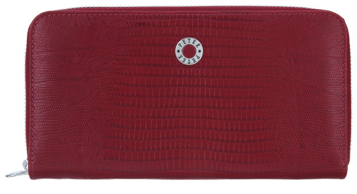 Портмоне женское Petek 1855, цвет: красный. 397/2.041.10397/2.041.10 RedСтильное женское портмоне Petek 1855 изготовлено из натуральной кожи с тиснением под рептилию. Портмоне закрывается на застежку-молнию. Внутри находятся два отделения для купюр, между которыми расположен карман на застежке-молнии для мелочи, двенадцать кармашков для визиток и пластиковых карт и два потайных кармана. Портмоне упаковано в фирменную коробку. Такое портмоне станет замечательным подарком человеку, ценящему качественные и практичные вещи.