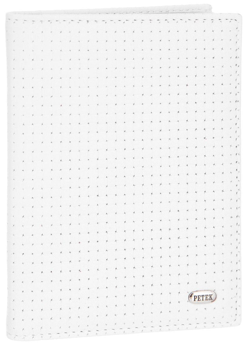Обложка для автодокументов Petek 1855, цвет: белый. 584.020.00584.020.00 WhiteОбложка для автодокументов Petek 1855 выполнена из высококачественной натуральной кожи и оформлена декоративным тиснением под плетение. На внутреннем развороте - съемный блок из шести прозрачных файлов из мягкого пластика, один из которых формата А5, два боковых кармана, один из которых сетчатый, и четыре прорезных кармашка для визиток и пластиковых карт. Обложка не только поможет сохранить внешний вид ваших документов и защитит их от повреждений, но и станет стильным аксессуаром, который подчеркнет ваш неповторимый стиль.