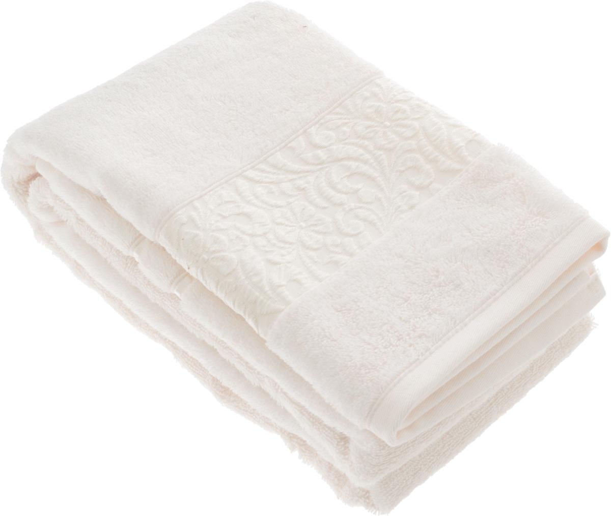 Полотенце бамбуковое Issimo Home Valencia, цвет: экрю, 70 x 140 см4753Полотенце Issimo Home Valencia выполнено из 60% бамбукового волокна и 40% хлопка. Таким полотенцем не нужно вытираться - только коснитесь кожи - и ткань сама все впитает. Такая ткань впитывает в 3 раза лучше, чем хлопок. Несмотря на высокую плотность, полотенце быстро сохнет, остается легкими даже при намокании. Изделие имеет красивый жаккардовый бордюр, оформленный цветочным орнаментом. Благородные, классические тона создадут уют и подчеркнут лучшие качества махровой ткани, а сочные, яркие, летние оттенки создадут ощущение праздника и наполнят дом энергией. Красивая, стильная упаковка этого полотенца делает его уже готовым подарком к любому случаю.