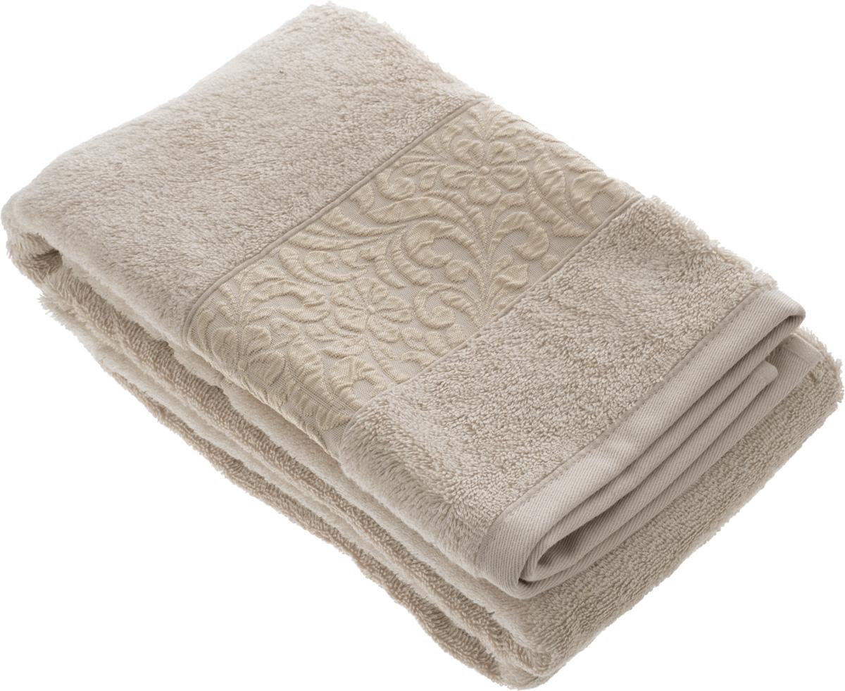 Полотенце бамбуковое Issimo Home Valencia, цвет: бежевый, 70 x 140 см4765Полотенце Issimo Home Valencia выполнено из 60% бамбукового волокна и 40% хлопка. Таким полотенцем не нужно вытираться - только коснитесь кожи - и ткань сама все впитает. Такая ткань впитывает в 3 раза лучше, чем хлопок. Несмотря на высокую плотность, полотенце быстро сохнет, остается легкими даже при намокании. Изделие имеет красивый жаккардовый бордюр, оформленный цветочным орнаментом. Благородные, классические тона создадут уют и подчеркнут лучшие качества махровой ткани, а сочные, яркие, летние оттенки создадут ощущение праздника и наполнят дом энергией. Красивая, стильная упаковка этого полотенца делает его уже готовым подарком к любому случаю.