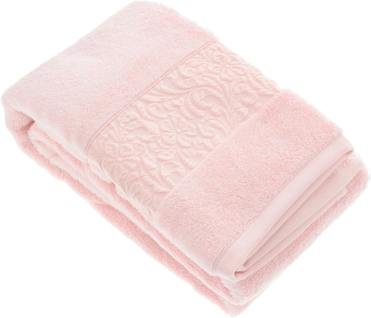 Полотенце бамбуковое Issimo Home Valencia, цвет: светло-розовый, 70 x 140 см4781Полотенце Issimo Home Valencia выполнено из 60% бамбукового волокна и 40% хлопка. Таким полотенцем не нужно вытираться - только коснитесь кожи - и ткань сама все впитает. Такая ткань впитывает в 3 раза лучше, чем хлопок. Несмотря на высокую плотность, полотенце быстро сохнет, остается легкими даже при намокании. Изделие имеет красивый жаккардовый бордюр, оформленный цветочным орнаментом. Благородные, классические тона создадут уют и подчеркнут лучшие качества махровой ткани, а сочные, яркие, летние оттенки создадут ощущение праздника и наполнят дом энергией. Красивая, стильная упаковка этого полотенца делает его уже готовым подарком к любому случаю.