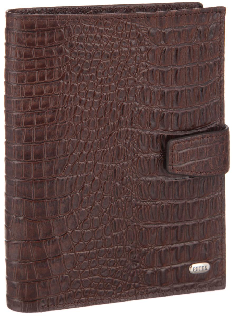 Обложка для паспорта и автодокументов Petek 1855, цвет: темно-коричневый. 596.067.02596.067.02 D.BrownОбложка для паспорта и автодокументов Petek 1855 выполнена из натуральной высококачественной кожи с тиснением под крокодила. Внутри имеет отделение для паспорта, два сетчатых боковых кармана и съемный блок из шести прозрачных файлов из мягкого пластика, один из которых формата А5. Обложка закрывается на хлястик с кнопкой. Обложка упакована в фирменную коробку. Изделие сочетает в себе классический дизайн и функциональность. Обложка не только поможет сохранить внешний вид ваших документов и защитит их от повреждений, но и станет стильным аксессуаром, который подчеркнет ваш неповторимый стиль.
