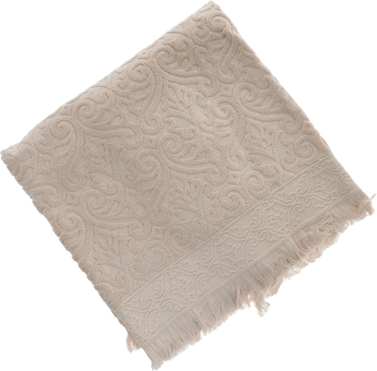 Полотенце махровое Issimo Home Tarren, цвет: бежевый, 90 x 150 см4957Полотенце Issimo Home Tarren выполнено из 100% хлопка с махровым рельефным узором. Изделие отлично впитывает влагу, быстро сохнет и не теряет форму даже после многократных стирок. Рекомендации по уходу: - режим стирки при 40°C, - допускается обычная химчистка, - отбеливание запрещено, - глажка при температуре подошвы утюга до 110°С, - барабанный отжим запрещен. Размер полотенца: 90 х 150 см.