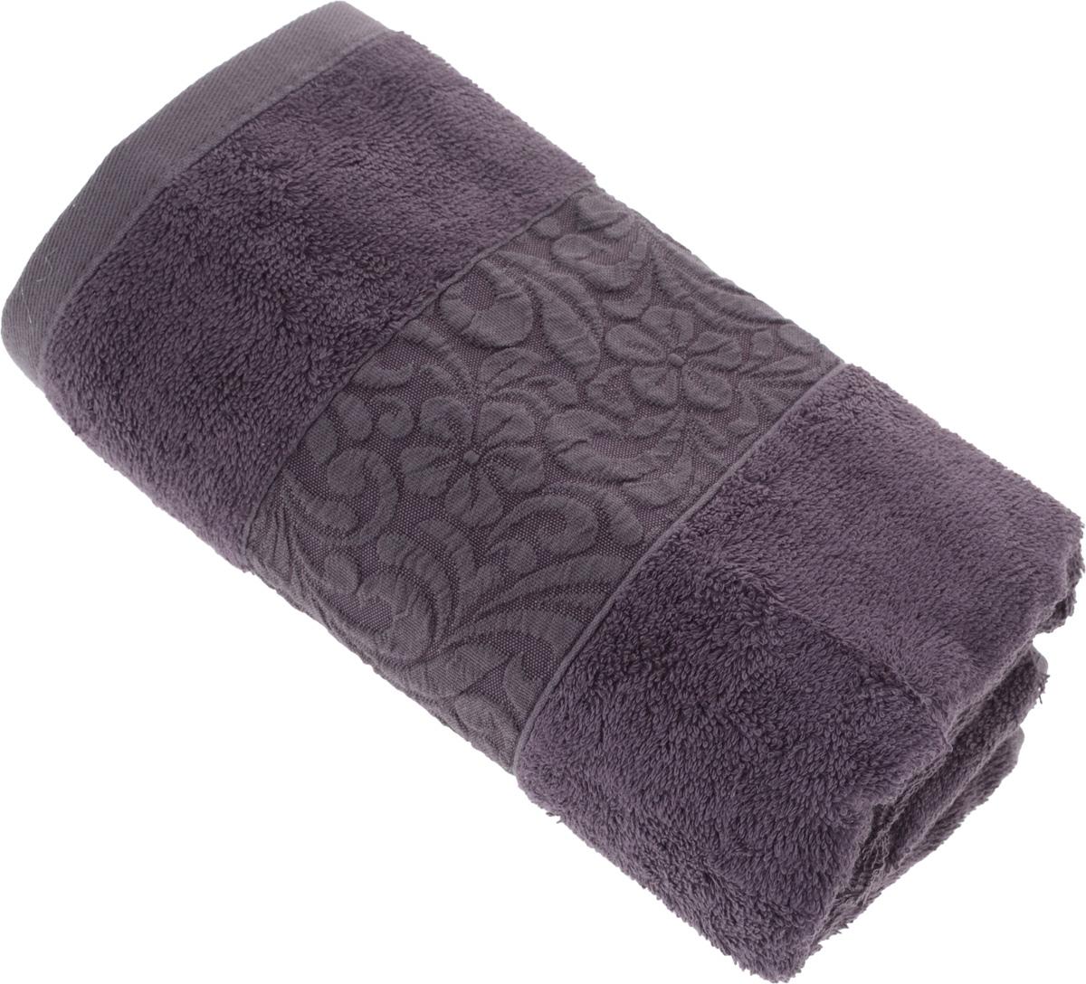Полотенце бамбуковое Issimo Home Valencia, цвет: пурпурный, 50 x 90 см4792Полотенце Issimo Home Valencia выполнено из 60% бамбукового волокна и 40% хлопка. Таким полотенцем не нужно вытираться - только коснитесь кожи - и ткань сама все впитает. Такая ткань впитывает в 3 раза лучше, чем хлопок. Несмотря на высокую плотность, полотенце быстро сохнет, остается легкими даже при намокании. Изделие имеет красивый жаккардовый бордюр, оформленный цветочным орнаментом. Благородные, классические тона создадут уют и подчеркнут лучшие качества махровой ткани, а сочные, яркие, летние оттенки создадут ощущение праздника и наполнят дом энергией. Красивая, стильная упаковка этого полотенца делает его уже готовым подарком к любому случаю.