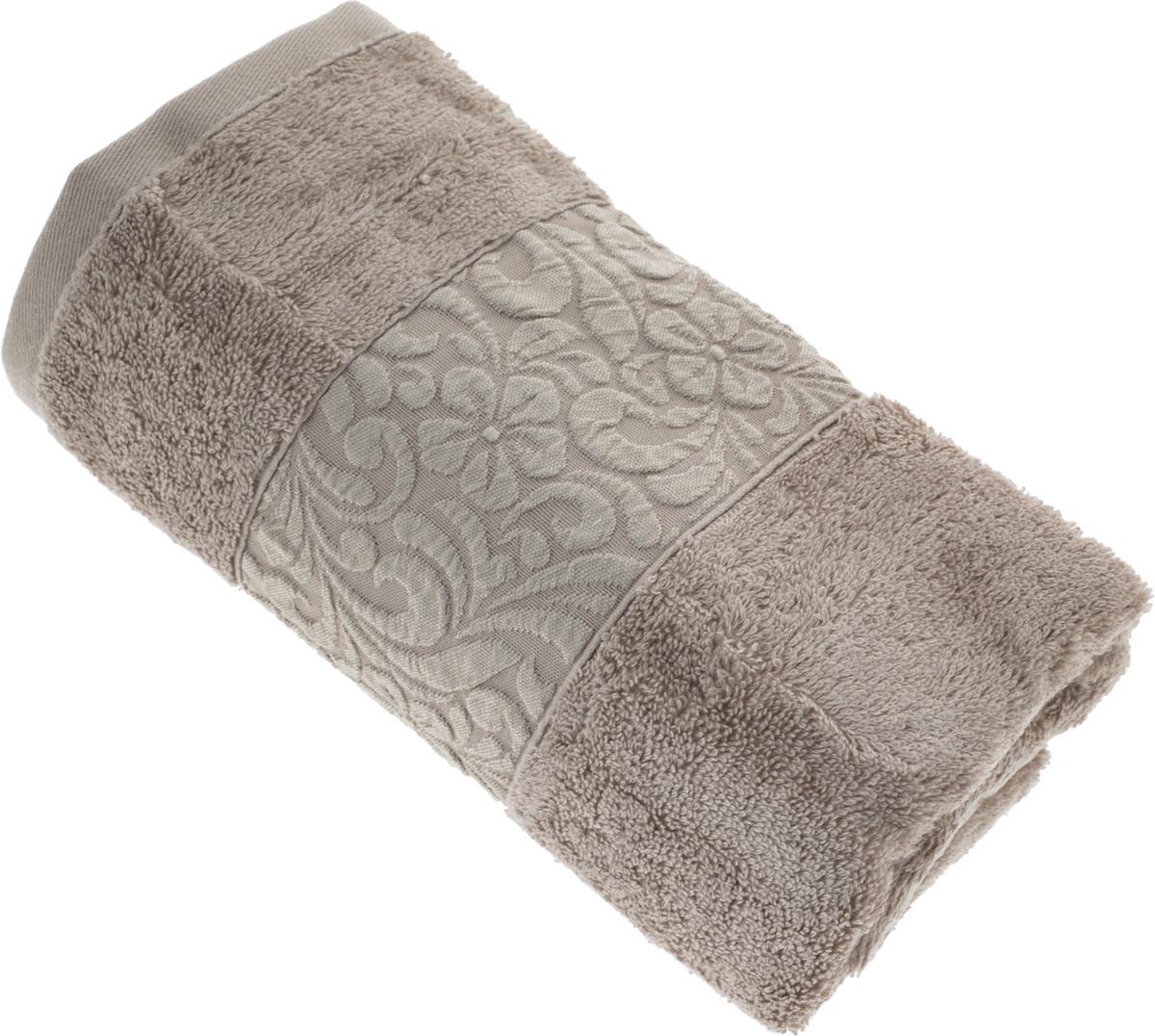 Полотенце бамбуковое Issimo Home Valencia, цвет: бежевый, 50 x 90 см4764Полотенце Issimo Home Valencia выполнено из 60% бамбукового волокна и 40% хлопка. Таким полотенцем не нужно вытираться - только коснитесь кожи - и ткань сама все впитает. Такая ткань впитывает в 3 раза лучше, чем хлопок. Несмотря на высокую плотность, полотенце быстро сохнет, остается легкими даже при намокании. Изделие имеет красивый жаккардовый бордюр, оформленный цветочным орнаментом. Благородные, классические тона создадут уют и подчеркнут лучшие качества махровой ткани, а сочные, яркие, летние оттенки создадут ощущение праздника и наполнят дом энергией. Красивая, стильная упаковка этого полотенца делает его уже готовым подарком к любому случаю.
