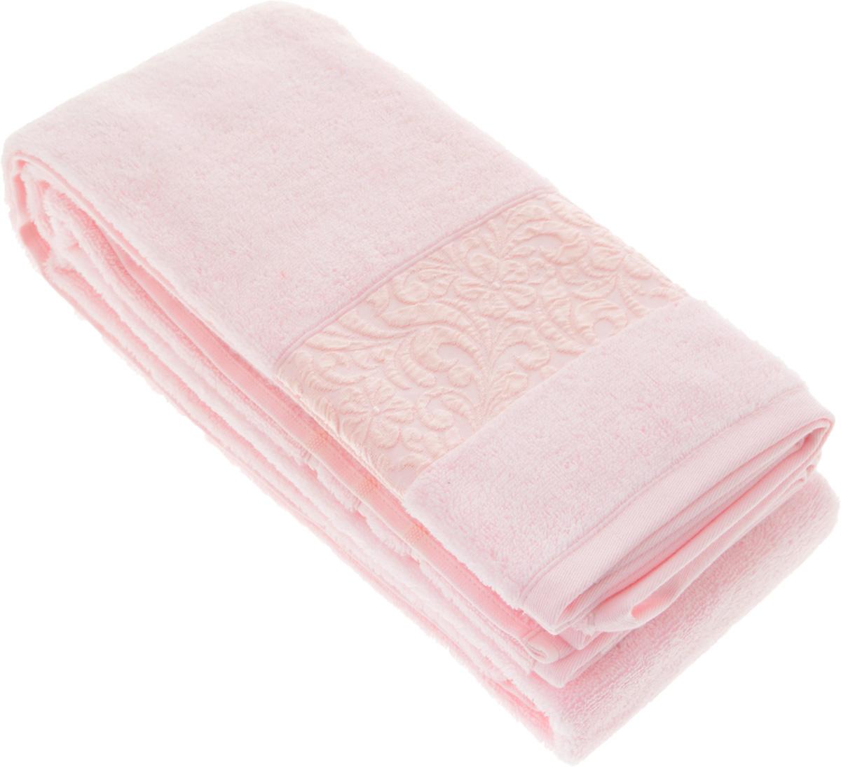 Полотенце бамбуковое Issimo Home Valencia, цвет: светло-розовый, 90 x 150 см4782Полотенце Issimo Home Valencia выполнено из 60% бамбукового волокна и 40% хлопка. Таким полотенцем не нужно вытираться - только коснитесь кожи - и ткань сама все впитает. Такая ткань впитывает в 3 раза лучше, чем хлопок. Несмотря на высокую плотность, полотенце быстро сохнет, остается легкими даже при намокании. Изделие имеет красивый жаккардовый бордюр, оформленный цветочным орнаментом. Благородные, классические тона создадут уют и подчеркнут лучшие качества махровой ткани, а сочные, яркие, летние оттенки создадут ощущение праздника и наполнят дом энергией. Красивая, стильная упаковка этого полотенца делает его уже готовым подарком к любому случаю.