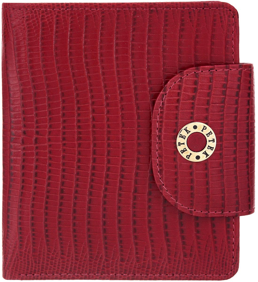 Портмоне женское Petek 1855, цвет: красный. 346.041.10346.041.10 RedСтильное женское портмоне Petek 1855 изготовлено из натуральной кожи с тиснением под рептилию. Портмоне закрывается на широкий хлястик с кнопкой. Внутри находятся два отделения для купюр, четыре кармашка для визиток и пластиковых карт, боковой карман, вертикальный карман, два потайных кармашка и карман на кнопке для мелочи. Портмоне упаковано в фирменную коробку. Такое портмоне станет замечательным подарком человеку, ценящему качественные и практичные вещи.