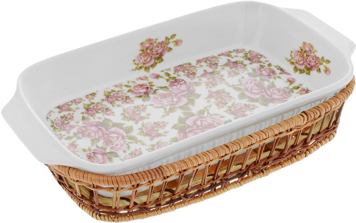 Форма для запекания Mayer & Boch Розы, прямоугольная, с корзиной, 35,5 х 18 х 5 см24804Прямоугольная форма Mayer & Boch Розы, выполненная из высококачественного фарфора белого цвета, оформлена красочным изображением цветов. Плетеная из ротанга корзина, в которую вставляется форма, послужит красивой и оригинальной подставкой. Фарфоровая посуда выдерживает высокие перепады температуры, поэтому ее можно использовать в духовке, микроволновой печи, а также для хранения пищи в холодильнике. Можно мыть в посудомоечной машине. Форма для запекания Mayer & Boch Розы прекрасно подойдет для приготовления овощей, мяса и других блюд, а оригинальный дизайн и яркое оформление украсят ваш стол. Размер формы (с учетом ручек): 35,5 х 18 х 5 см. Размер корзины: 32 х 19,6 х 5,7 см.