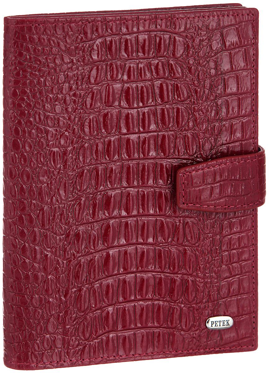 Обложка для паспорта и автодокументов Petek 1855, цвет: темно-красный. 596.067.10596.067.10 RedОбложка для паспорта и автодокументов Petek 1855 выполнена из натуральной кожи с тиснением под крокодила. Внутри имеет отделение для паспорта, два боковых сетчатых кармана и съемный блок из шести прозрачных файлов из мягкого пластика, один из которых формата А5. Обложка закрывается на хлястик с кнопкой. Обложка упакована в фирменную коробку. Изделие сочетает в себе классический дизайн и функциональность. Обложка не только поможет сохранить внешний вид ваших документов и защитит их от повреждений, но и станет стильным аксессуаром, который подчеркнет ваш неповторимый стиль.