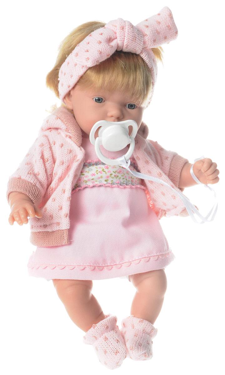 Arias Пупс озвученный Elegance цвет наряда розовыйТ58639Озвученный пупс Arias Elegance порадует вашу малышку и подарит массу положительных эмоций. Кукла выполнена с анатомической точностью и выглядит совсем как настоящий малыш. Ручки, ножки и голова подвижны и изготовлены из высококачественного материала. Тело мягконабивное. Кукла одета в наряд нежно-розового цвета, который состоит из платья, теплой кофты с капюшоном и носочков. Голову пупса украшает повязка с бантиком, которая делает игрушку очень милой. Также в набор входит пустышка. Нажмите на животик пупса - и он засмеется, второй раз - скажет мама, третий раз - скажет папа. Игра с куклой учит детей проявлять заботу, доброту и выражать свои чувства. Рекомендуется докупить 3 батарейки типа AG13/LR44 (товар комплектуется демонстрационными).