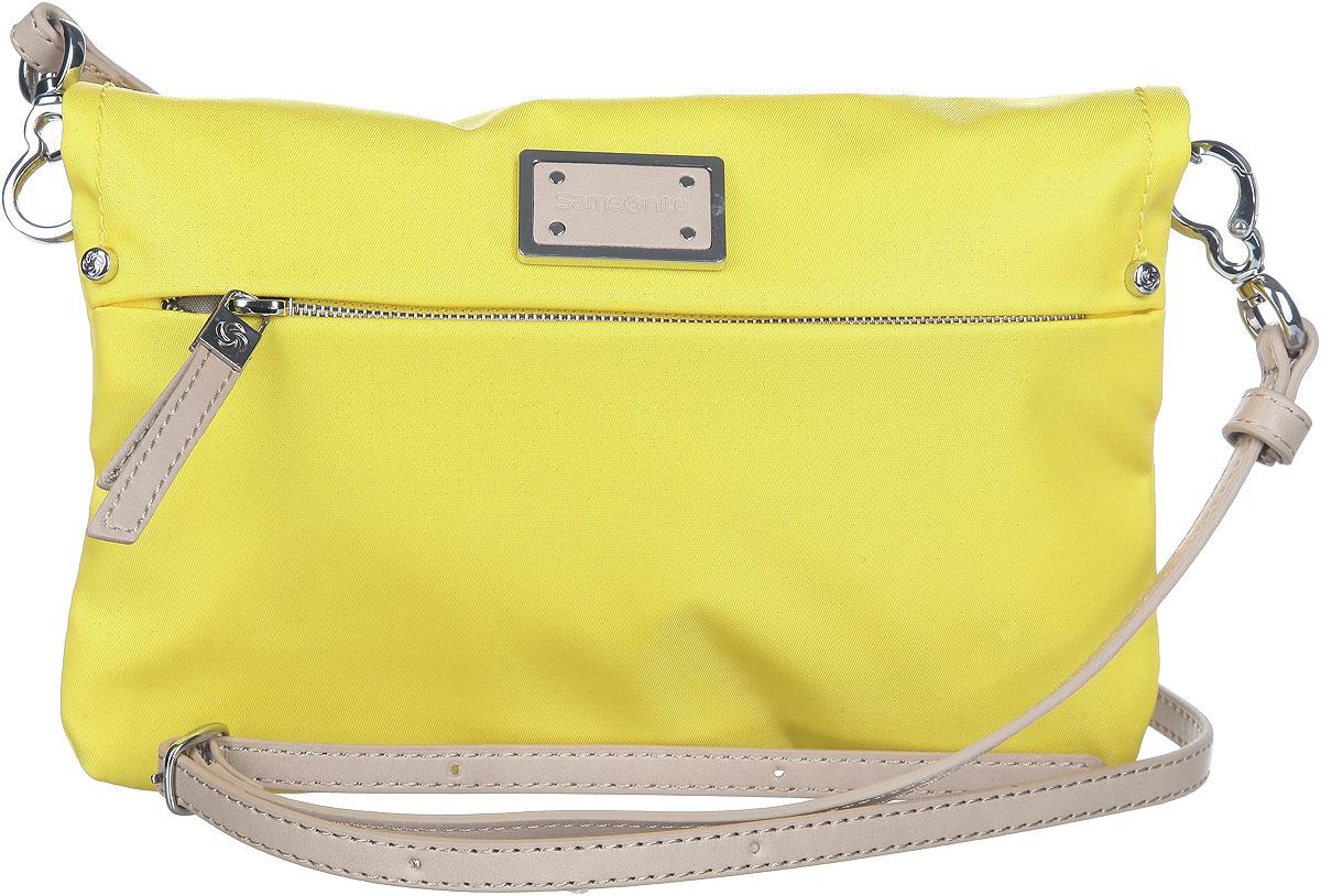 Сумка женская Samsonite, цвет: желтый. 22D-0601222D-06012Изысканная женская сумка Samsonite выполнена из нейлона. Сумка закрывается на магниты. В раскрытом виде сумка с двух сторон содержит врезной карман на молнии. На лицевой стороне модель также оснащена врезным карманом на замке-молнии. Сумка имеет съемный плечевой ремень регулируемой длины, выполненный из искусственной кожи бежевого цвета. Спереди сумка декорирована металлической вставкой с эмблемой бренда. Практичная и стильная сумка прекрасно завершит ваш образ.