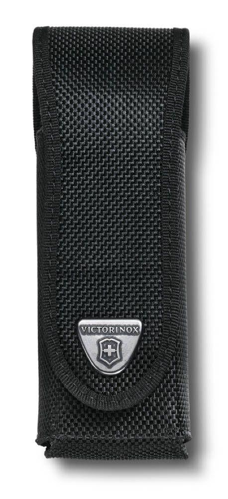 Чехол для ножей Victorinox RangerGrip, цвет: черный. 4.0504.34.0504.3Victorinox 4.0504.3 - чехол для ножей и новинка 2015 года. Впервые на рынке. Практически единственный чехол для новой коллекции Delemont RangerGrip. Прочный и практичный черный нейлоновый чехол с длинным клапаном. На клапане расположена металлическая бляха с логотипом компании Victorinox. Есть отсрочка черной лентой по канту. В нижней части чехла по бокам присутствуют прорези, препятствующие скоплению мусора и отвода влаги. Каждый чехол Victorinox очень и очень качественный, поскольку каждый специально разрабатывается и производится для определенных моделей швейцарских ножей, будь то SwissTool или другой любой другой швейцарский нож. Это означает, что Victorinox позаботились, как о прочности конструкции, так и о элегантном дизайне. Подходит для ножей 130 мм нейлон