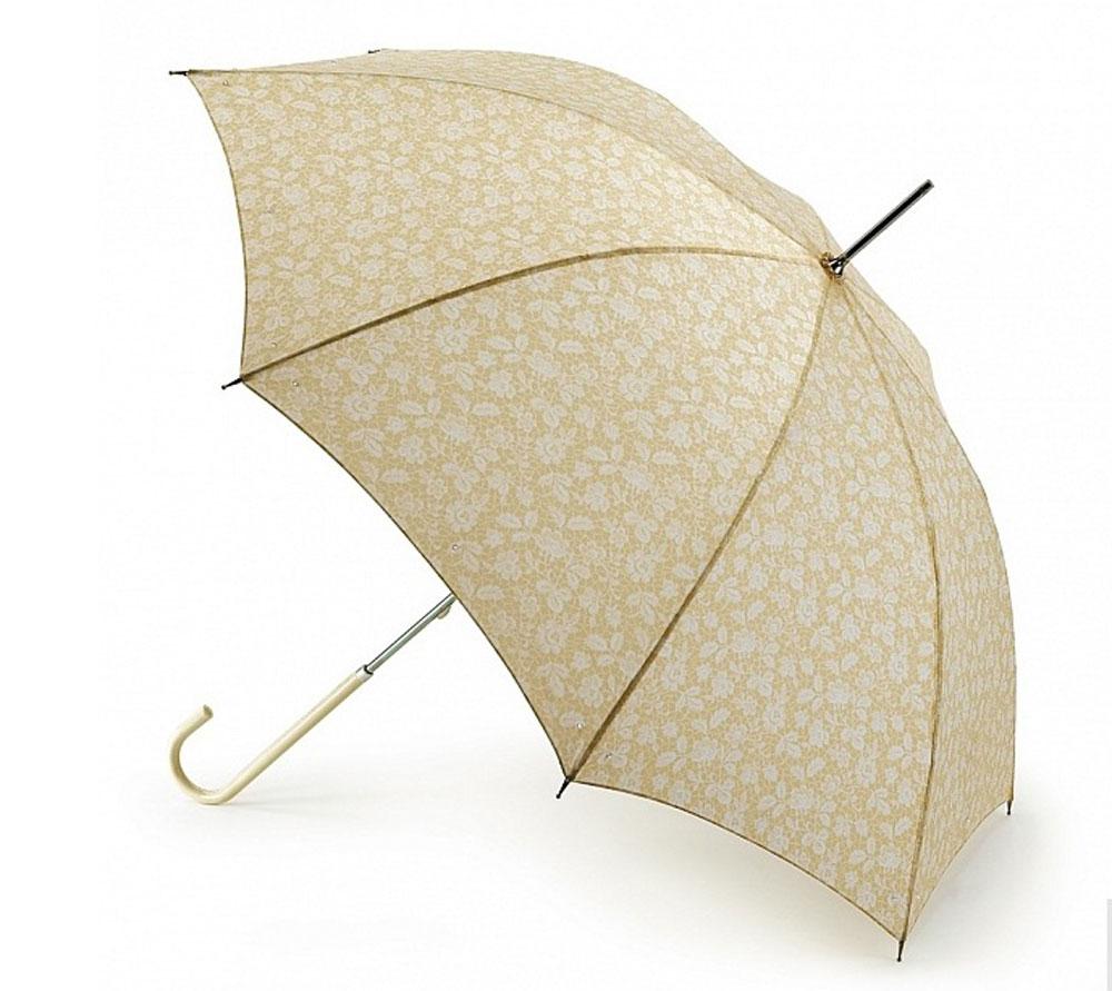 Зонт-трость женский Fulton Eliza, механический, цвет: белый, кремовый. L600-2767L600-2767 BrugesLaceМодный механический зонт-трость в стиле ретро Fulton Eliza даже в ненастную погоду позволит вам оставаться стильной и элегантной. Каркас зонта включает 8 спиц из фибергласса. Стержень изготовлен из стали. Купол зонта выполнен из прочного полиэстера и оформлен нежным цветочным принтом. По внешнему краю купол украшен пришитыми стразами. Изделие дополнено удобной пластиковой рукояткой, обтянутой натуральной кожей. Зонт механического сложения: купол открывается и закрывается вручную до характерного щелчка. Модель застегивается с помощью хлястика на кнопку. Такой зонт не только надежно защитит вас от дождя, но и станет стильным аксессуаром, который идеально подчеркнет ваш неповторимый образ.