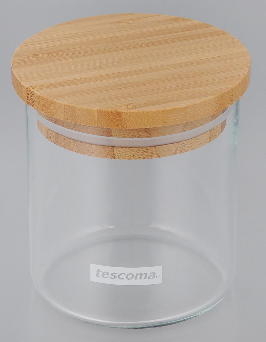 Емкость для сыпучих продуктов Tescoma Fiesta, 500 мл894620Емкость для сыпучих продуктов Tescoma Fiesta изготовлена из боросиликатного стекла. Крышка, выполненная из первоклассной древесины бамбука, дополнена силиконовой прокладкой для того, чтобы продукты дольше оставались свежими и ароматными. Банка подходит для хранения круп, муки, чая, соли, панировочных сухарей и многого другого. Исключительный внешний вид изделия позволяет идеально вписать его в любой интерьер. Можно мыть в посудомоечной машине. Диаметр: 9,5 см. Высота (без учета крышки): 10,5 см.