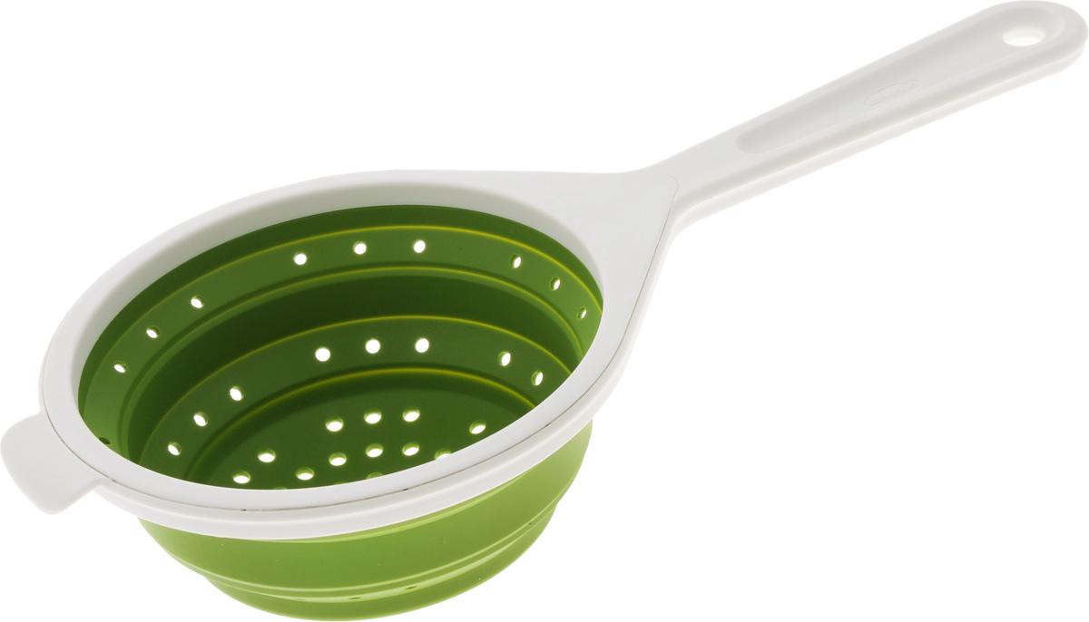 Дуршлаг Chefn, складной, цвет: зеленый, белый, диаметр 14 см102-019-011ЕДуршлаг Chefn, изготовленный из высококачественного пластика и силикона, станет полезным приобретением для вашей кухни. Изделие оснащено ручкой для комфортного использования. Дуршлаг предназначен для отделения жидкости от твердых веществ, например, после варки макаронных изделий, круп, картофеля. Также он используется для мытья и промывания ягод, грибов, мелких фруктов и овощей. Дуршлаг компактно складывается, что делает его удобным для хранения. Можно мыть в посудомоечной машине. Внутренний диаметр: 14 см. Размер (в разложенном виде): 33,5 х 15 х 7 см. Размер (в сложенном виде): 33,5 х 15 х 2 см.