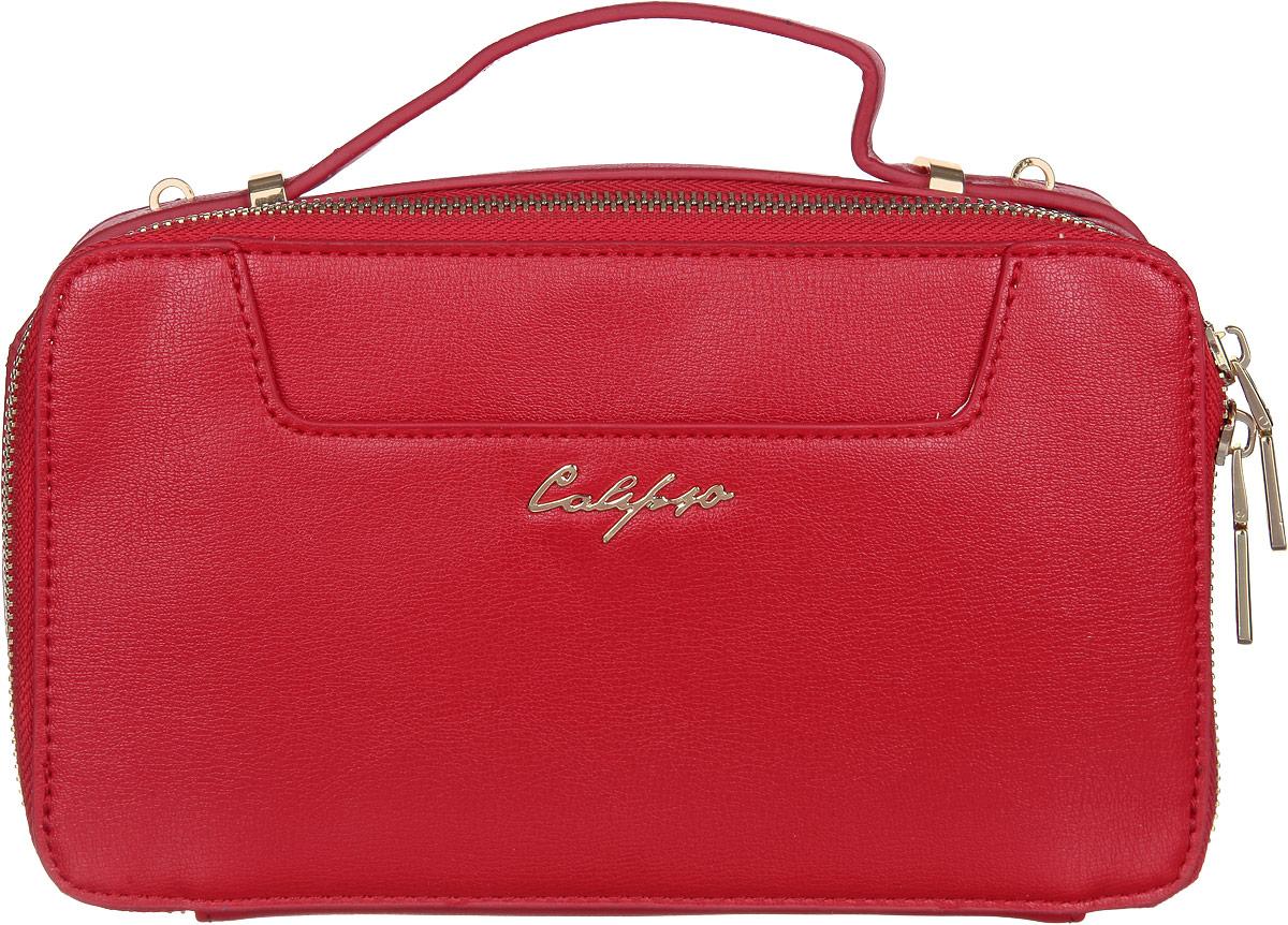Сумка женская Calipso, цвет: красный. 817-041286-172817-041286-172Прелестная женская сумка Calipso выполнена из искусственной кожи. Изделие имеет одно основное отделение. Закрывается сумка на застежку-молнию. Внутри находятся карман на застежке-молнии и два накладных открытых кармана. Снаружи, на передней и задней стенках расположены накладные карманы, один из которых на магнитной кнопке. Модель оснащена одной удобной ручкой. В комплект входит съемный наплечный регулируемый ремень. Роскошная сумка внесет элегантные нотки в ваш образ и подчеркнет ваше отменное чувство стиля.