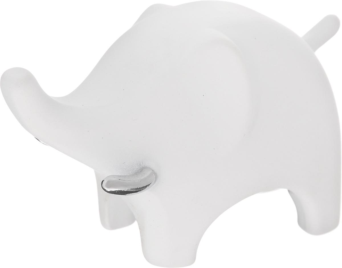 Подставка для колец Umbra Слон, цвет: белый299114-153Подставка для колец Umbra Слон изготовлена из цинка. Изделие выполнено в виде слона. Изящная подставка оригинального дизайна станет изысканным подарком для модницы, ценящей красивые и оригинальные вещицы. Подставка для колец Umbra Слон благодаря своей практичности и необычности станет не только идеальным подарком представительнице прекрасного пола, но и изысканным украшением интерьера. Размер фигурки: 7 х 3 х 4,5 см.