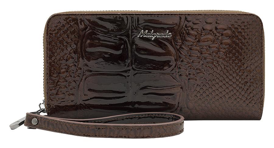 Кошелек Malgrado, цвет: коричневый. 73005-0440373005-04403# Brown Клатч MalgradoСтильный кошелек Malgrado изготовлен из лаковой натуральной кожи коричневого цвета с тиснением под рептилию и закрывается на молнию. Внутри расположены четыре основных отделения, одно из которых на молнии, по четыре кармашка на боковых стенках для карточек, визиток, кредиток и два кармашка побольше, в которые можно положить пропуск, проездной билет или фотографию. В комплект также входит кожаный ремешок для удобной переноски. Кошелек упакован в фирменную коробку с логотипом фирмы.