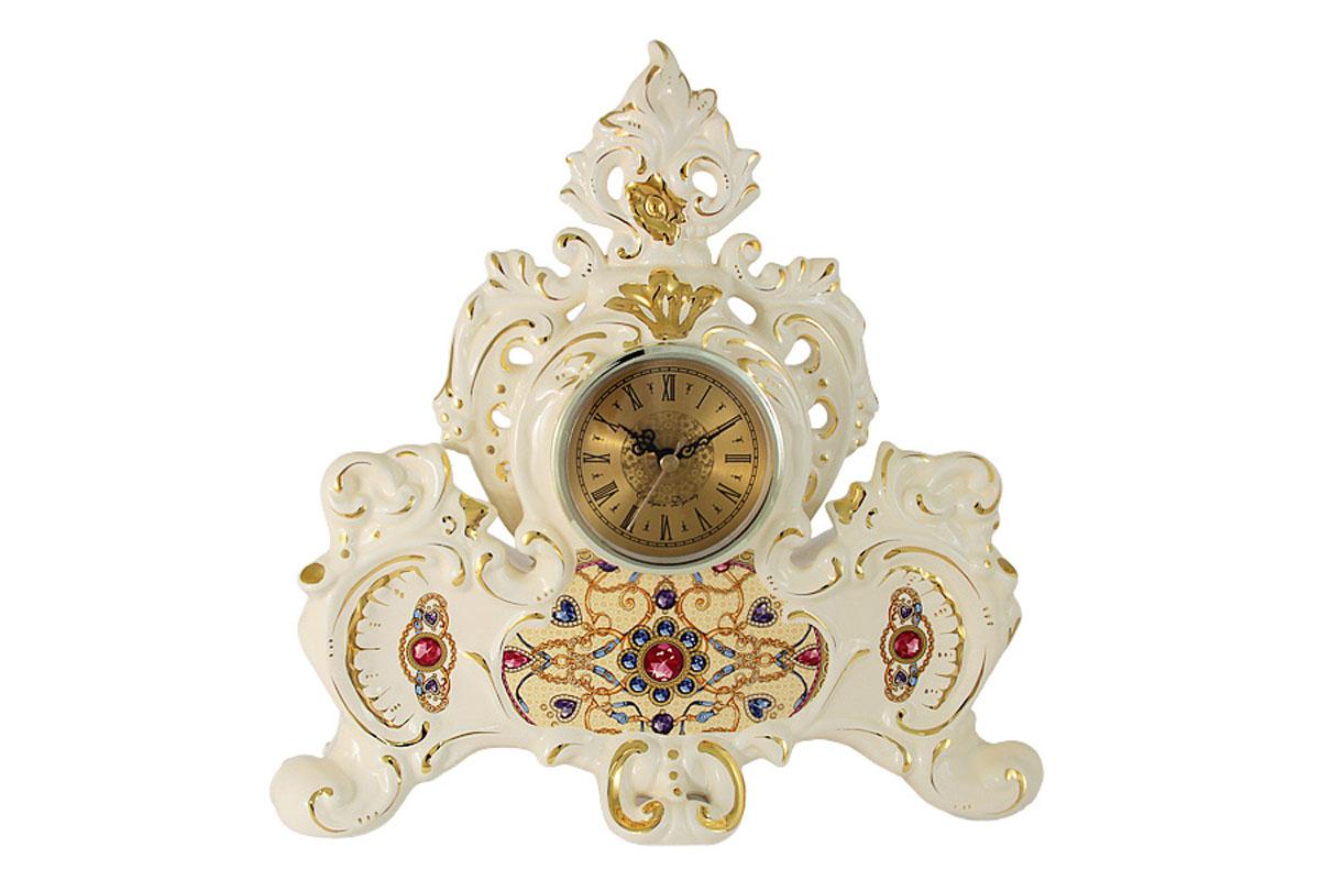Часы настольные Babyzon Dynasty РубинBD-E336-453-ALКомпания Babyzon Dynasty основана в 2007 году в Китае. В ассортименте компании представлены предметы украшения интерьера из керамики. Декоративные вазы, блюда, тарелки, подсвечники, настольные часы выполнены в стиле ампир и барокко и напоминают пышное убранство дворцов французских королей 18 века. Практически за 10 лет существования, компания успела наработать серьезный производственный опыт и создать коллекции, отличающиеся прекрасным качеством и приемлемой ценой. Состав:керамика.Обязательной сертификации не подлежит.Протирать сухой/влажной салфеткой.