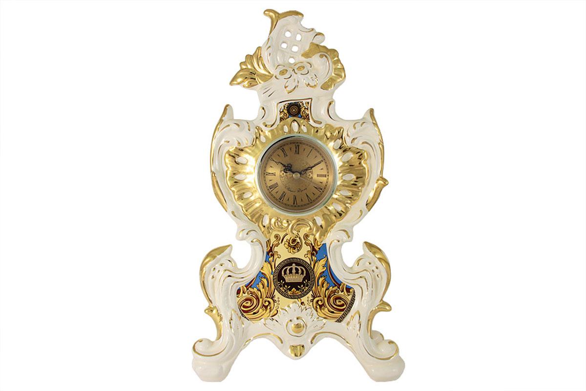 Часы настольные Babyzon Dynasty КоронаBD488-540A1-ALКомпания Babyzon Dynasty основана в 2007 году в Китае. В ассортименте компании представлены предметы украшения интерьера из керамики. Декоративные вазы, блюда, тарелки, подсвечники, настольные часы выполнены в стиле ампир и барокко и напоминают пышное убранство дворцов французских королей 18 века. Практически за 10 лет существования, компания успела наработать серьезный производственный опыт и создать коллекции, отличающиеся прекрасным качеством и приемлемой ценой. Состав:керамика.Обязательной сертификации не подлежит.Протирать сухой/влажной салфеткой.