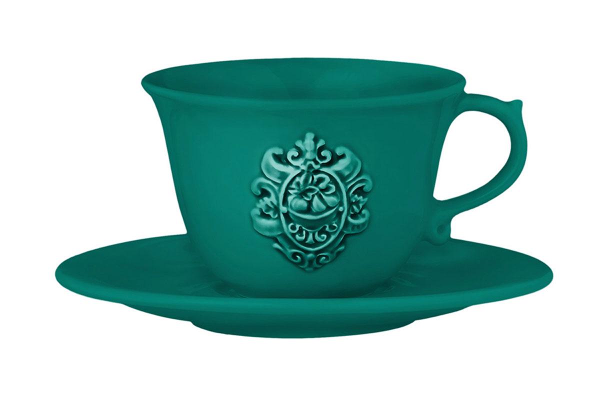 Чашка с блюдцем Nuova Cer Аральдо, цвет: бирюзовыйNC8303-VAM-ALДекорам торговой марки Nuova Сer присущи тёплые оттенки и верность истинно итальянскому стилю, для которого характерным является довольно толстая, нарочито простая керамическая посуда с красочной, яркой глазурью, с наивной росписью и орнаментами. Ее с легкостью можно подобрать в тон интерьеру кухни. Состав:керамика.Мыть мягкими моющими средствами. Не рекомендуется использовать посуду в микроволновой печи и мыть в посудомоечной машине.