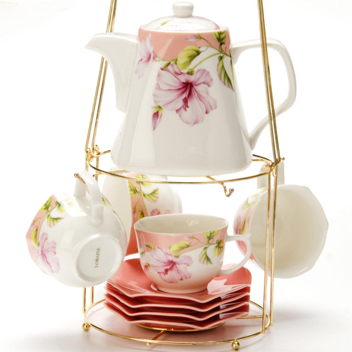 Набор чайный Mayer & Boch, на подставке, 9 предметов. 2473724737Чайный набор LORAINE состоит из 4 чашек, 4 блюдец и заварочного чайника (1,1 л). Предметы набора изготовлены из керамики и оформлены изображением цветов. Все предметы располагаются на удобной металлической подставке с ручкой. Элегантный дизайн набора придется по вкусу и ценителям классики, и тем, кто предпочитает утонченность и изысканность. Он настроит на позитивный лад и подарит хорошее настроение с самого утра. Чайный набор LORAINE идеально подойдет для сервировки стола и станет отличным подарком к любому празднику.