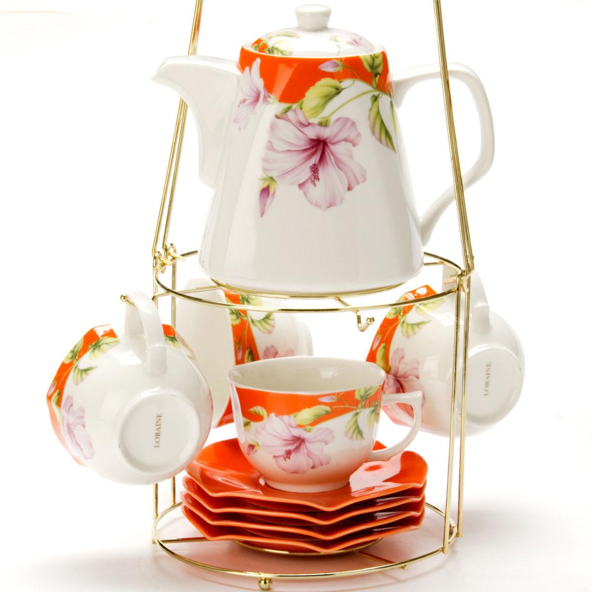 Набор чайный Mayer & Boch, на подставке, 9 предметов. 2473924739Чайный набор LORAINE состоит из 4 чашек, 4 блюдец и заварочного чайника (1,1 л). Предметы набора изготовлены из керамики и оформлены изображением цветов. Все предметы располагаются на удобной металлической подставке с ручкой. Элегантный дизайн набора придется по вкусу и ценителям классики, и тем, кто предпочитает утонченность и изысканность. Он настроит на позитивный лад и подарит хорошее настроение с самого утра. Чайный набор LORAINE идеально подойдет для сервировки стола и станет отличным подарком к любому празднику.
