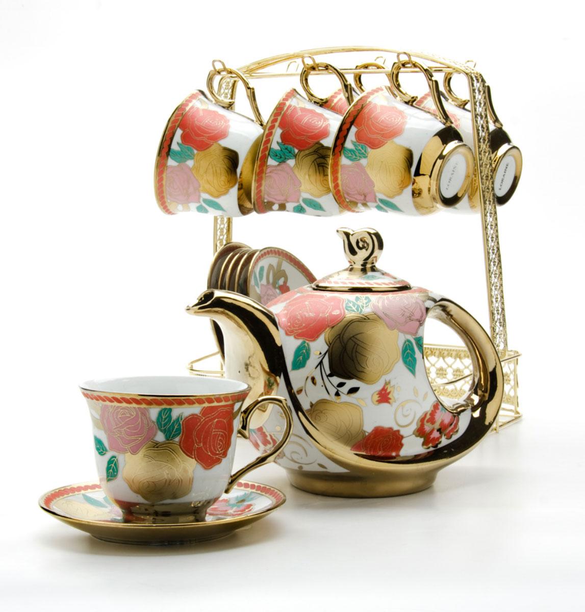 Набор чайный Loraine, на подставке, 15 предметов. 2478424784Чайный набор LORAINE состоит из шести чашек, шести блюдец и заварочного чайника. Предметы набора изготовлены из керамики и оформлены изображением цветов и бабочек. Все предметы располагаются на удобной металлической подставке с ручкой. Элегантный дизайн набора придется по вкусу и ценителям классики, и тем, кто предпочитает утонченность и изысканность. Он настроит на позитивный лад и подарит хорошее настроение с самого утра. Чайный набор LORAINE идеально подойдет для сервировки стола и станет отличным подарком к любому празднику.